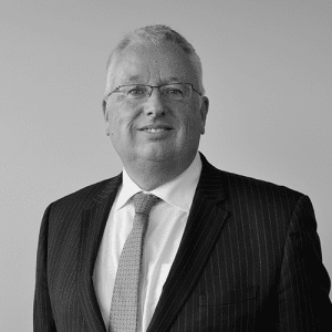 jon round PRIMIS group financial services director in black and white