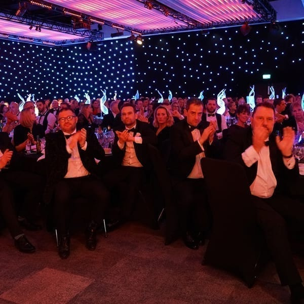 brokers in black tie applauding the recognising excellence event in 2019