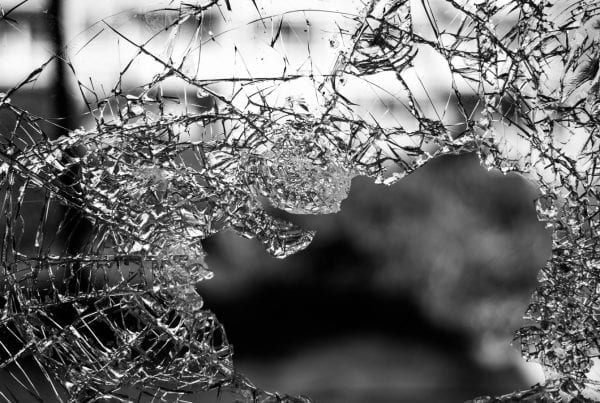 smashed and broken glass that needs insurance from vandals